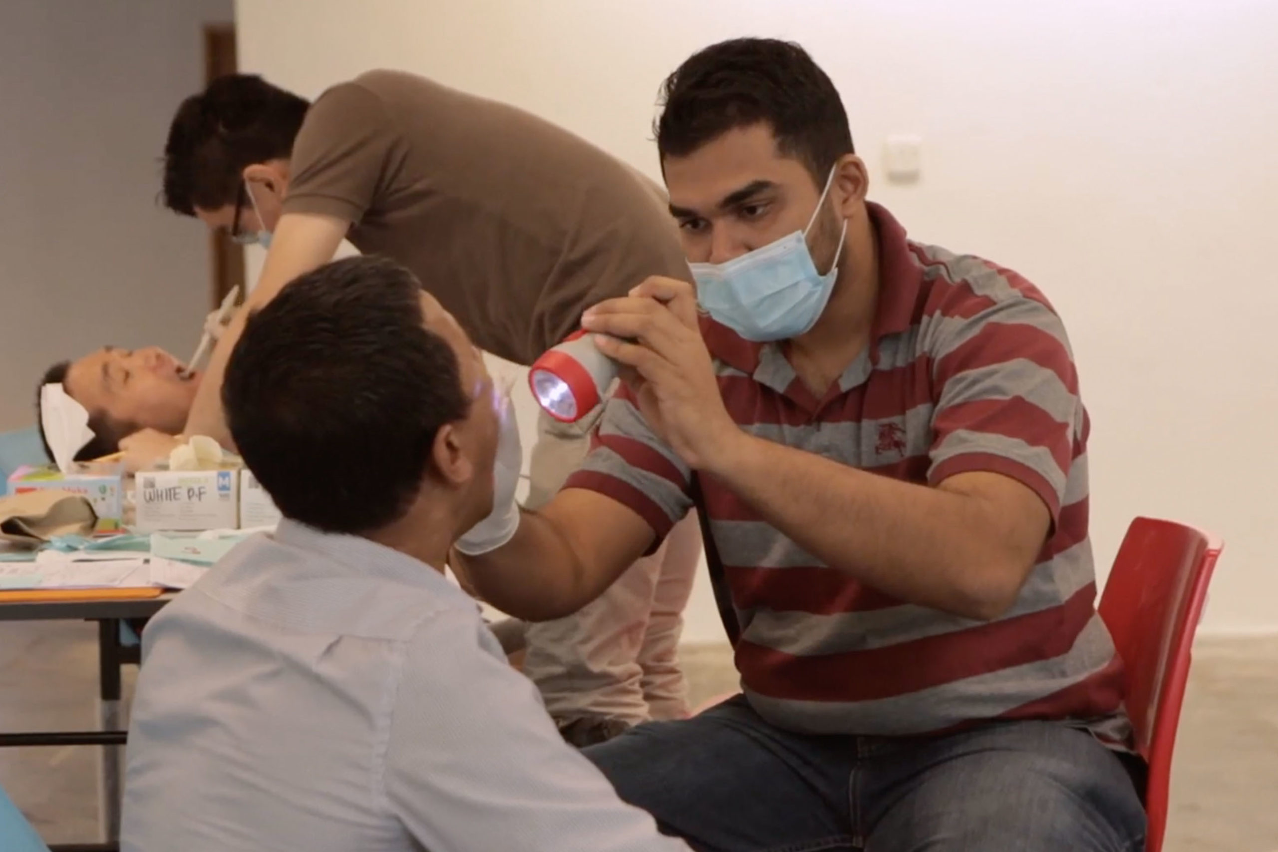 Dental checkups being given as part of the free health screenings offered under the Migrant Health Checkup Programme